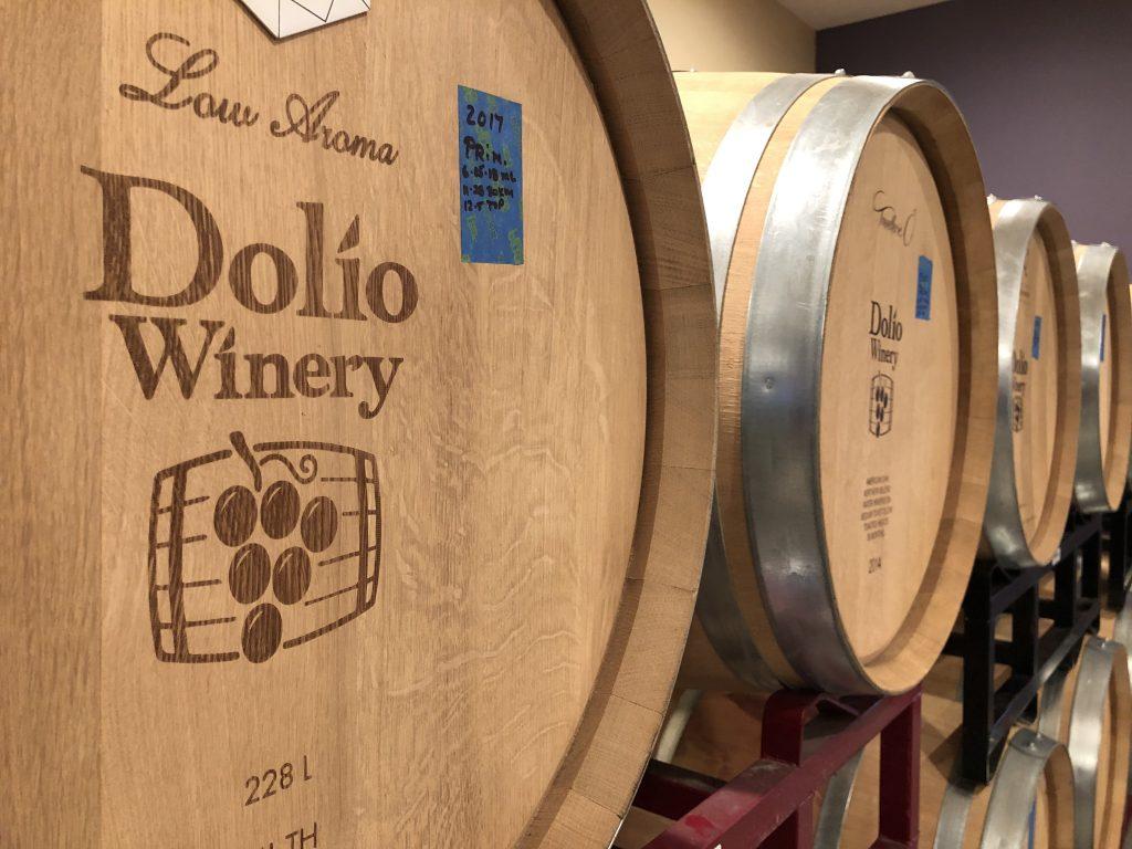 Filled wine barrels inside Dolio Winery's barrel room