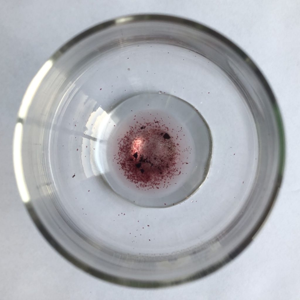 Sediment at the bottom of wine glass